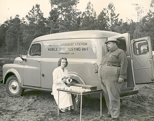 Researchers pose with the Georgia Experiment Station Mobile Soil Testing Unit, circa early 1950s
