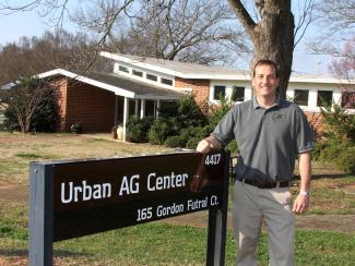 Greg Huber in front of the Urban Ag building
