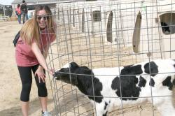 Lizza Isgar petting a calf at UGA-Tifton