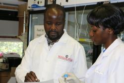Daniel Mwalwayo and Ruth Wangia in a UGA lab