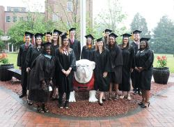 2017 Spring Graduates with UGA Dog.
