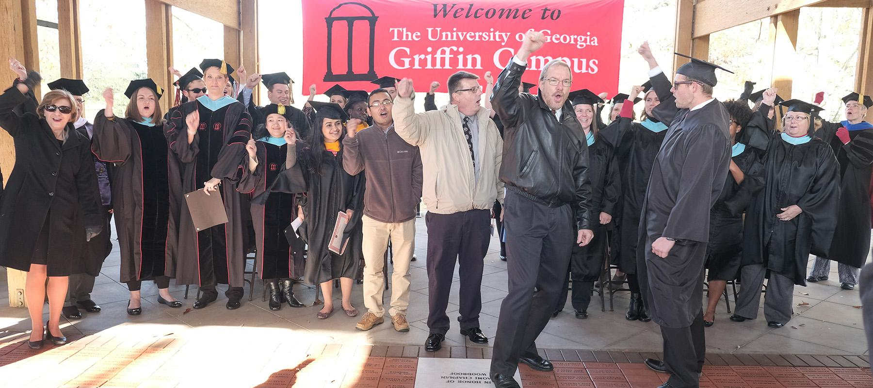 Bill Blum (UGA-Griffin retiree), Wayne Harvester (CFS IT), and Julie Cook (CAES Program Coordinator) lead Fall 2016 grads in a cheer