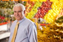Mike Doyle standing the produce section of a grocery store